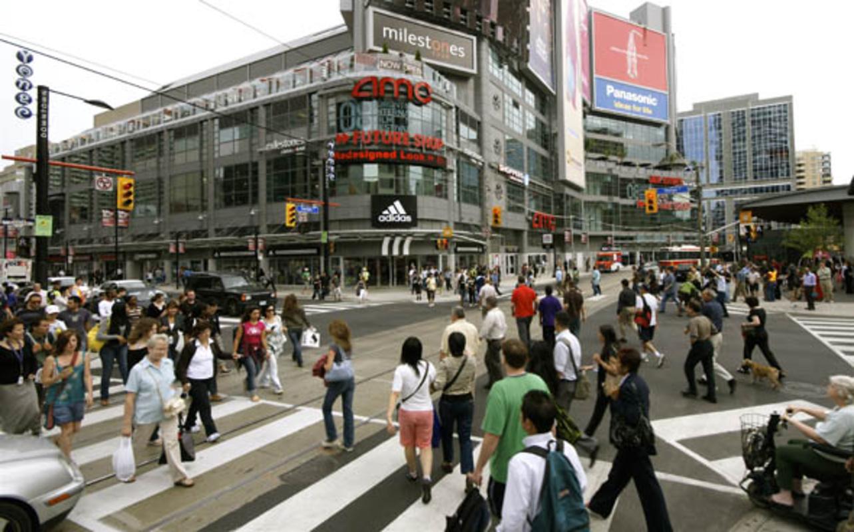 Pedestrians Scramble at Yonge & Dundas Intersection in Toronto