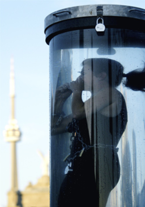 Kristen Johnson performs the Water Torture Cell stunt at the CNE in Toronto