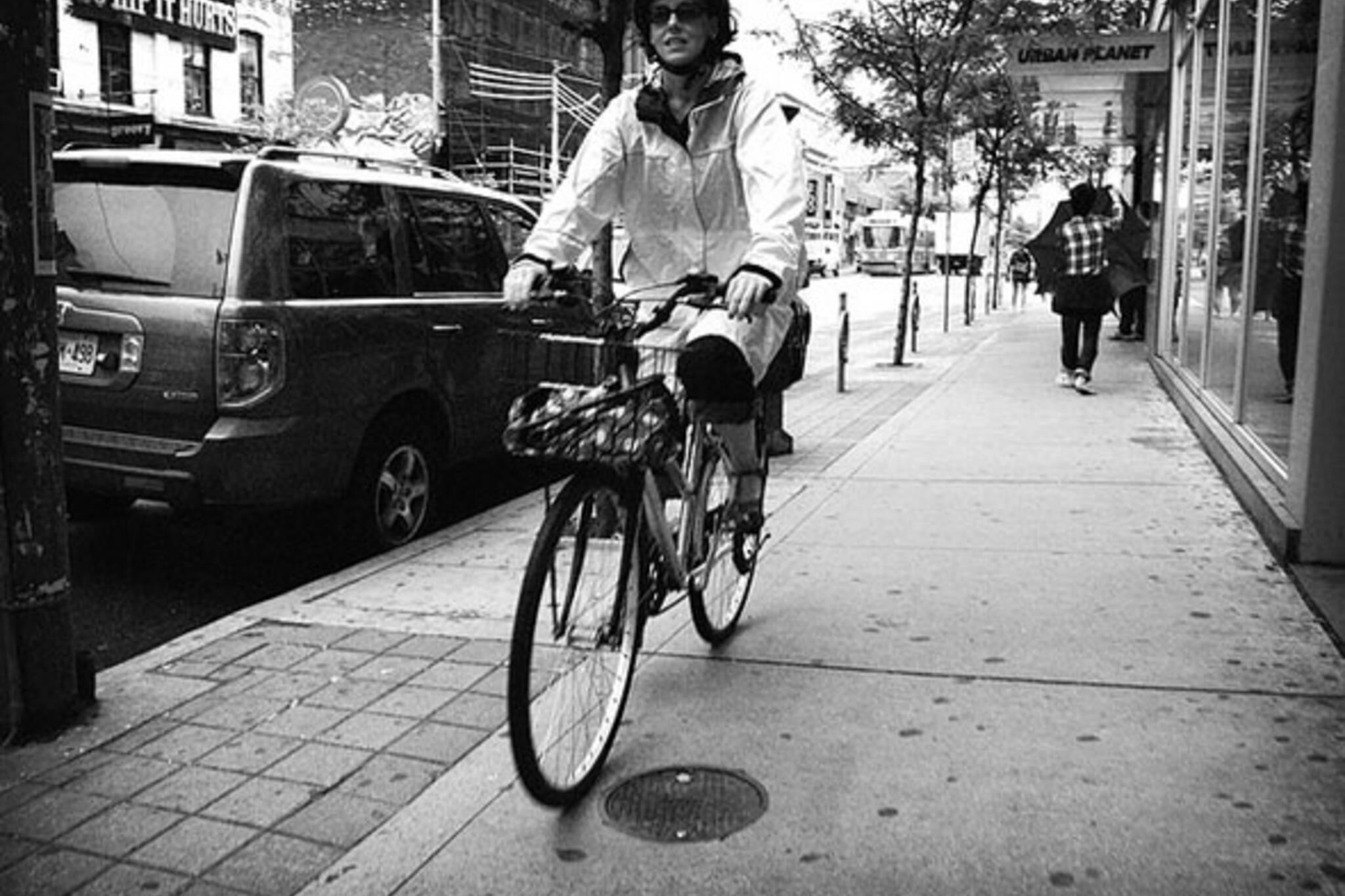 toronto cyclist riding on the sidewalk