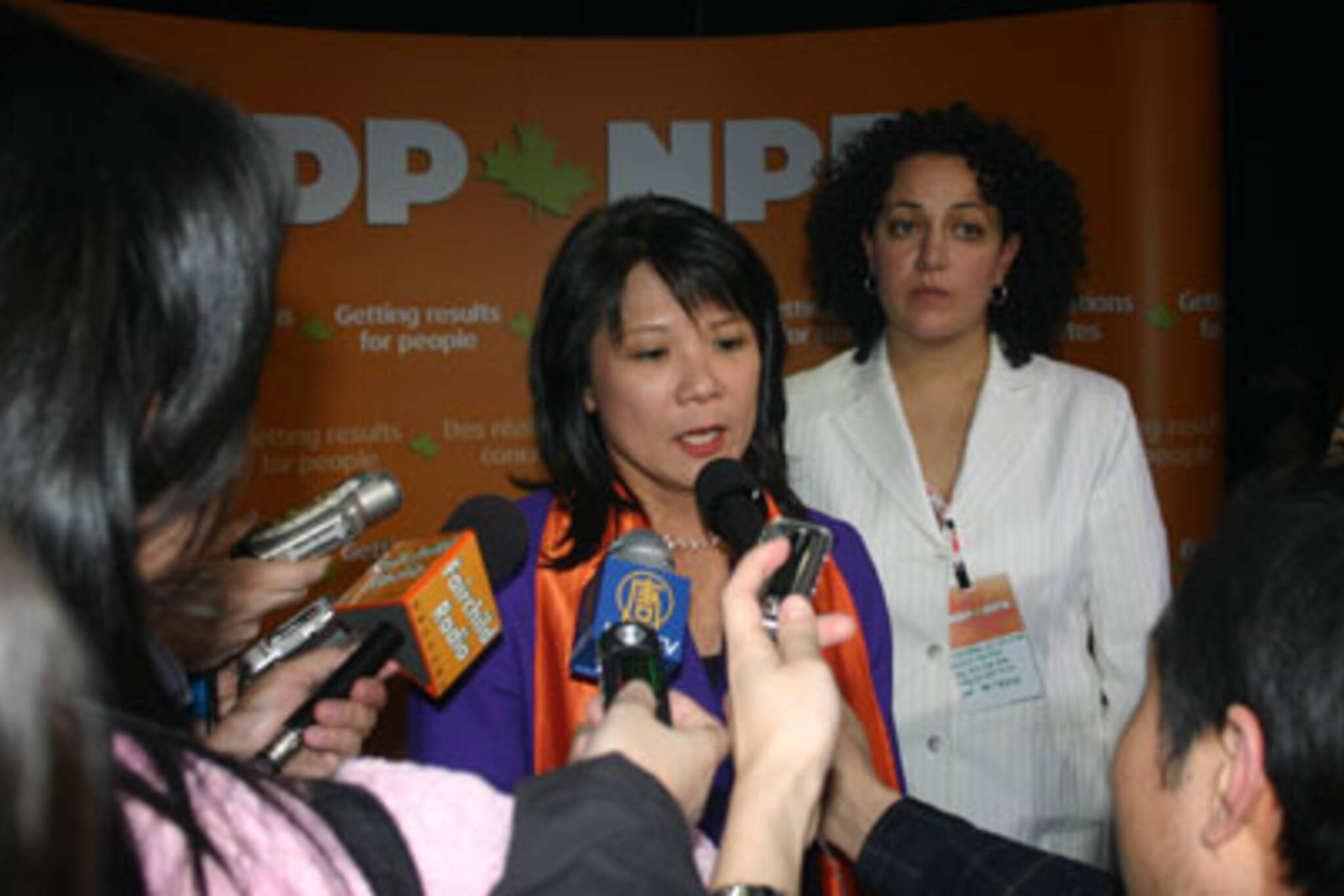 Newly minted MP Olivia Chow jumps into a press scrum after her victory was announced