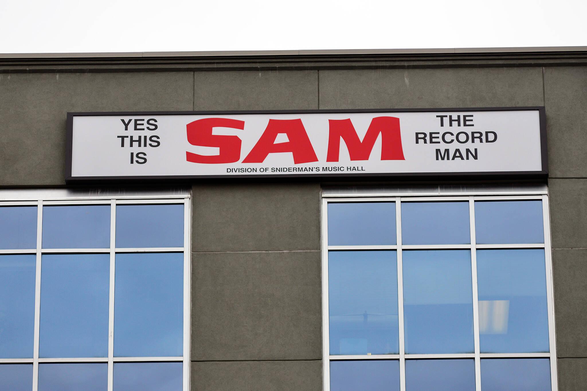 sam record man sign