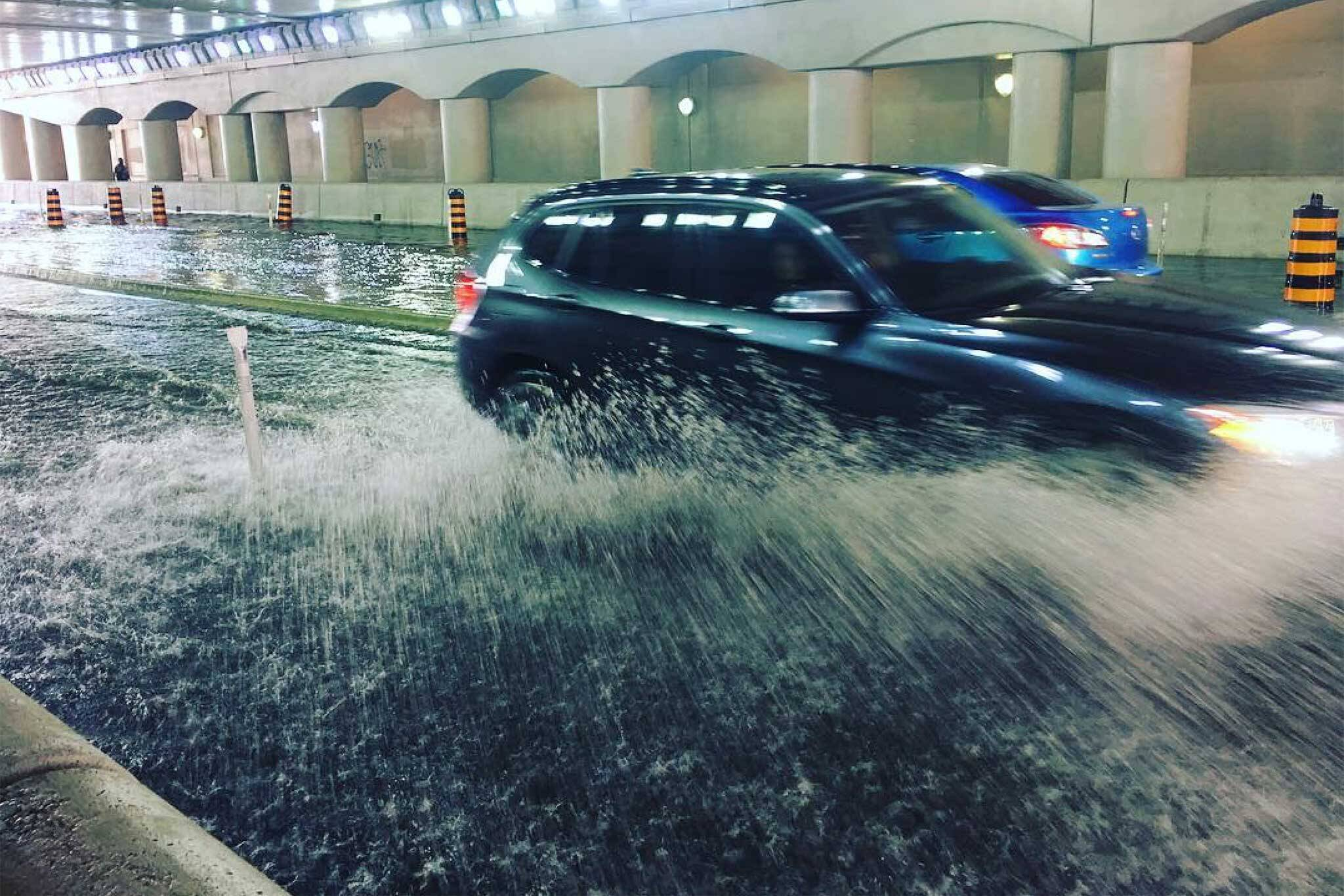 Drivers Forced To Wade Cars Through Flooded Toronto Street