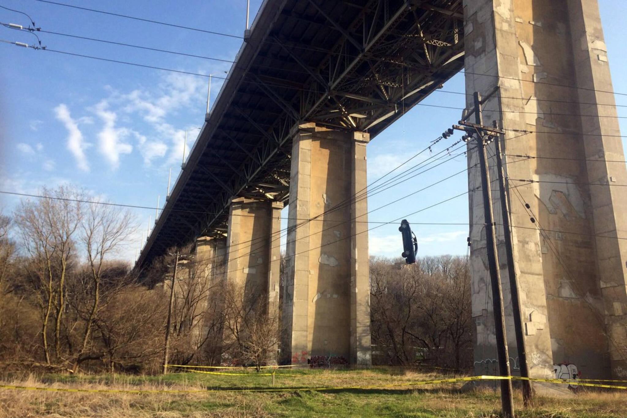 Car dangling off bridge