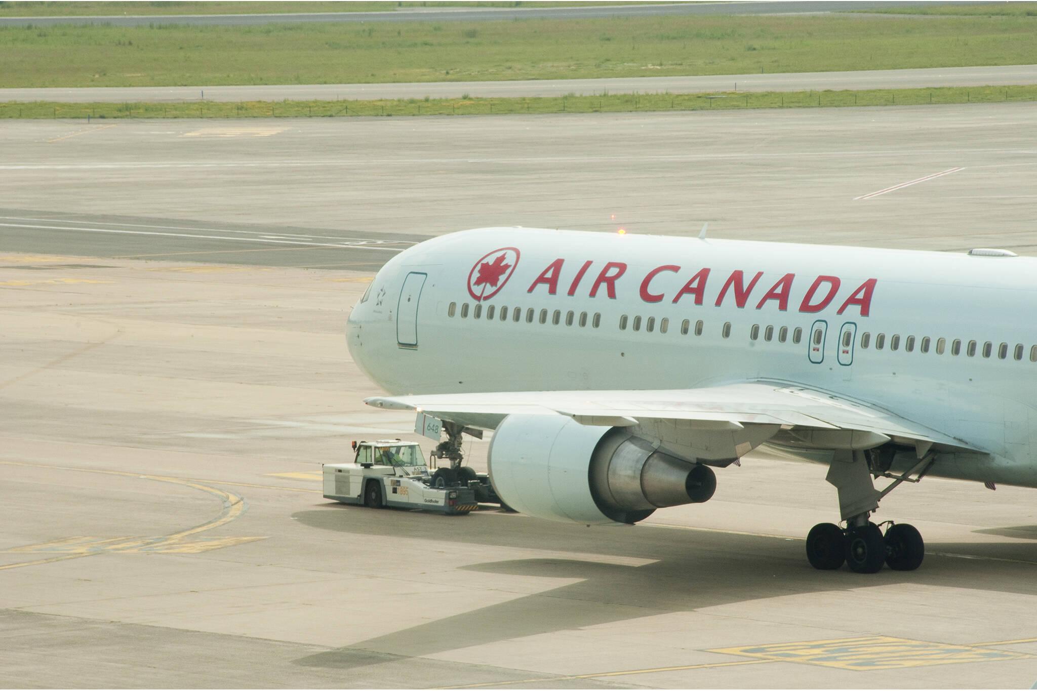 air canada passenger left alone