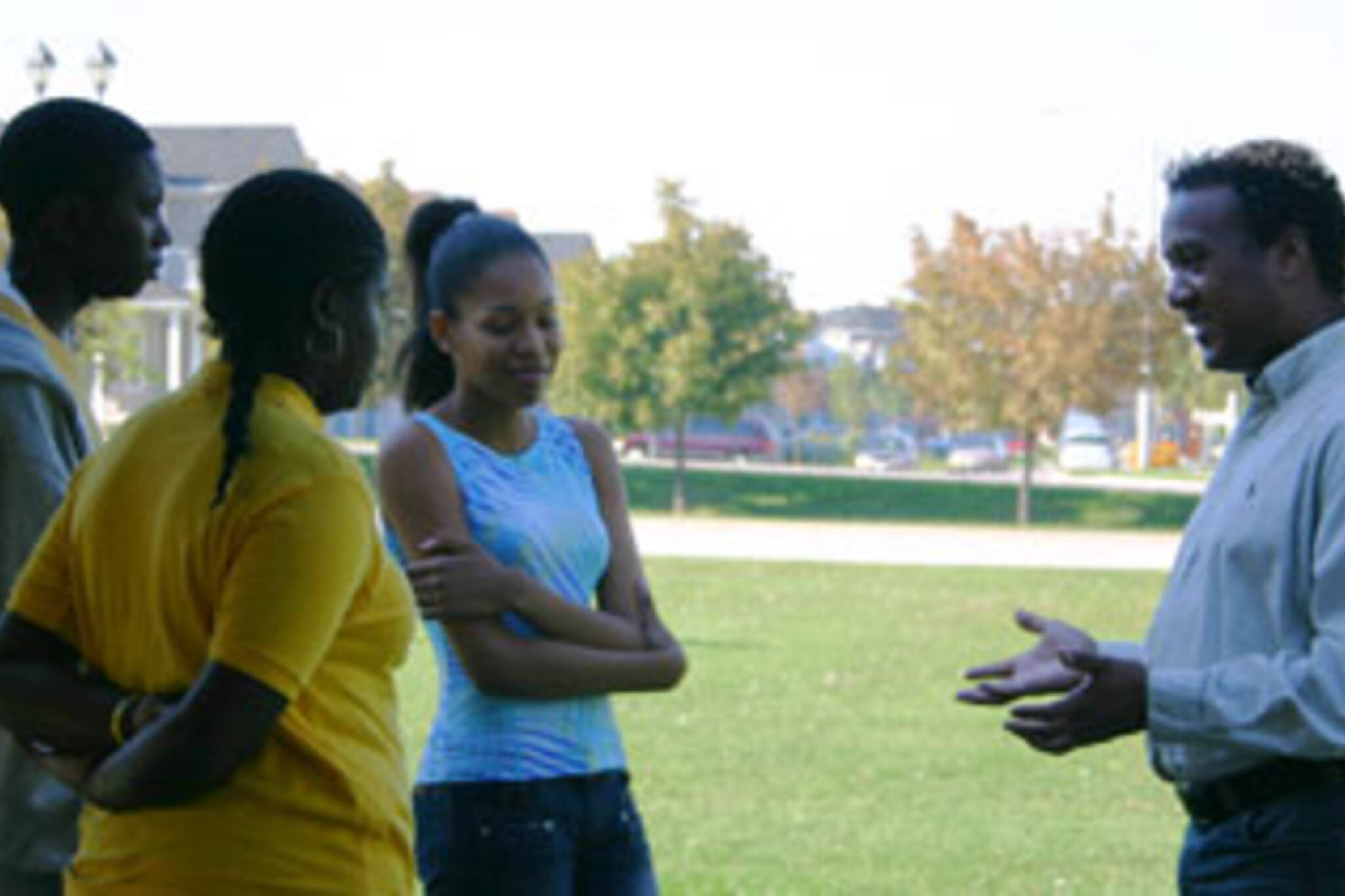 Donald Blair (right) talks to a group of youth at his kick-off barbecue