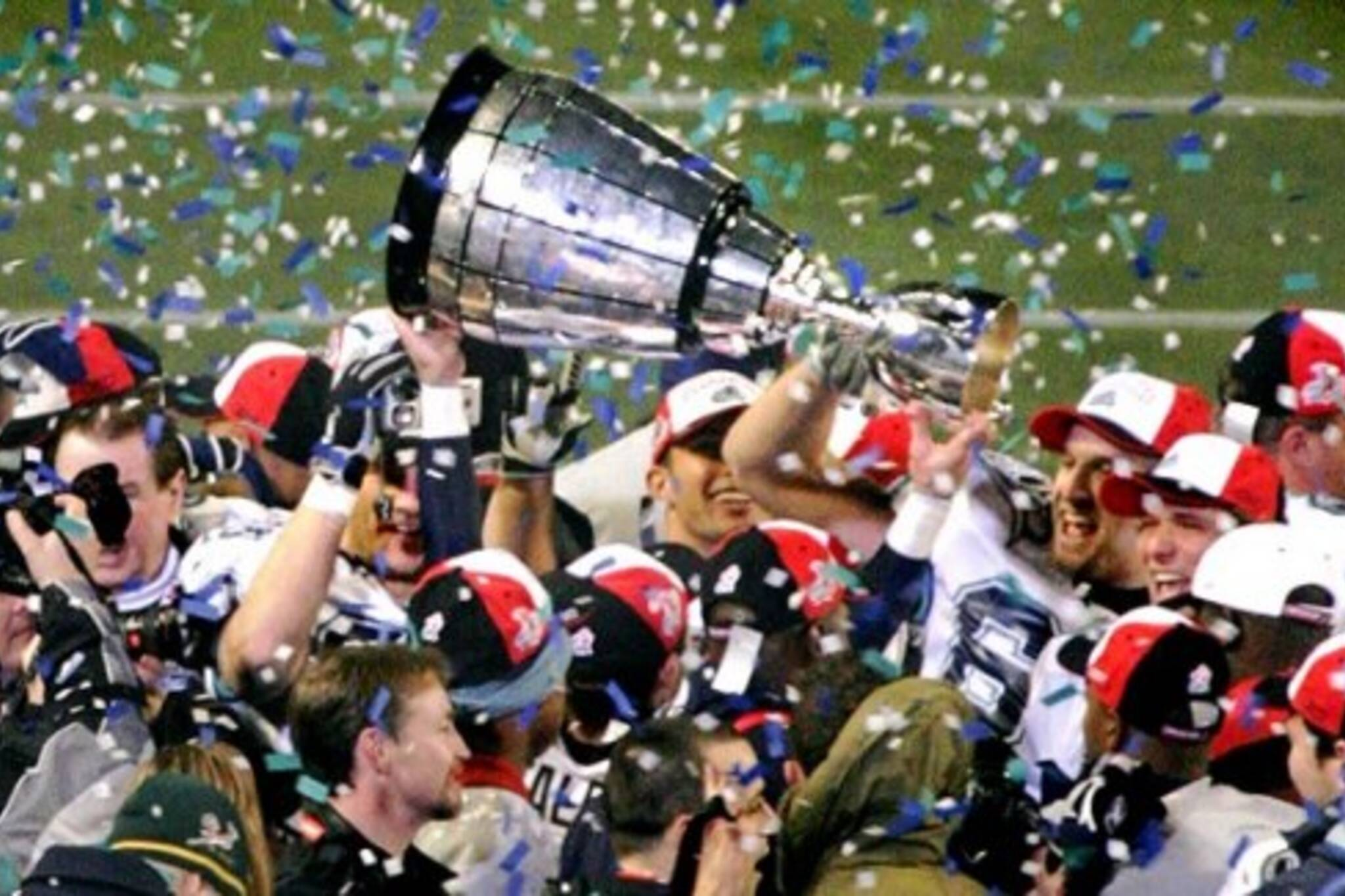 Argos celebrate Grey Cup victory in 2004 under coach Pinball Clemons, hired by J.I. Albrecht