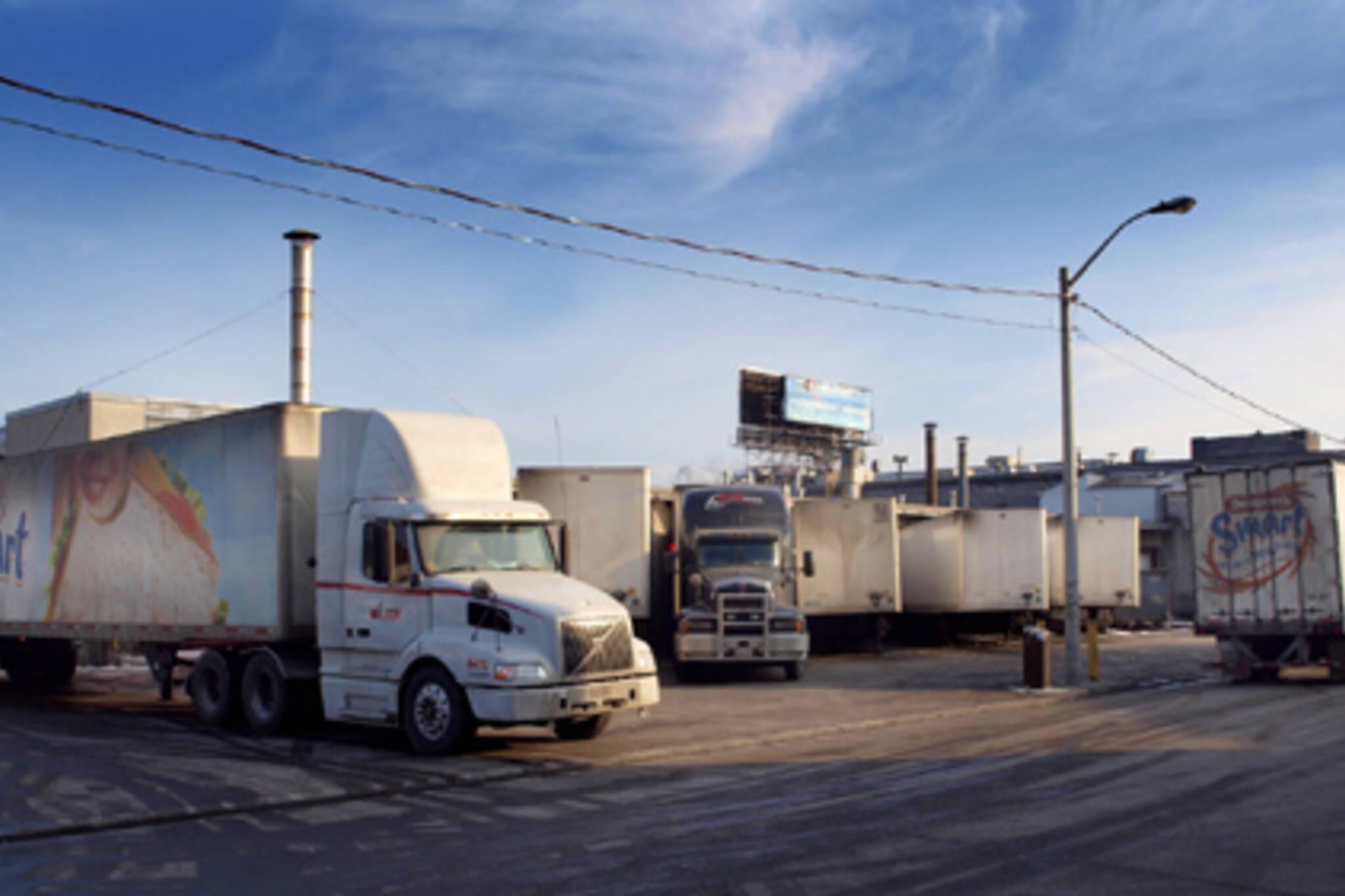 Trucks parked outside Canada Bread on Fraser