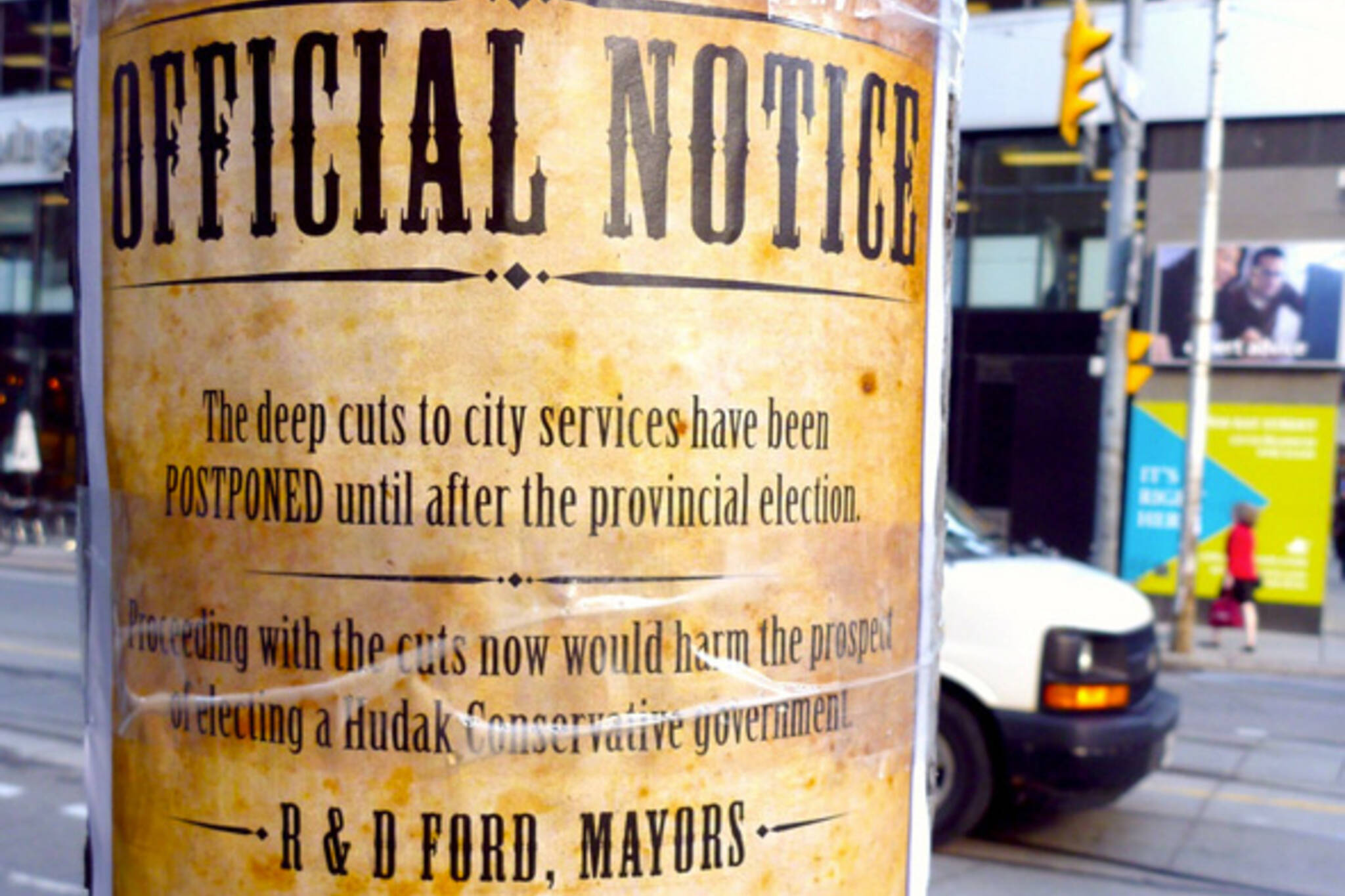 Official Notice service cuts Toronto street art