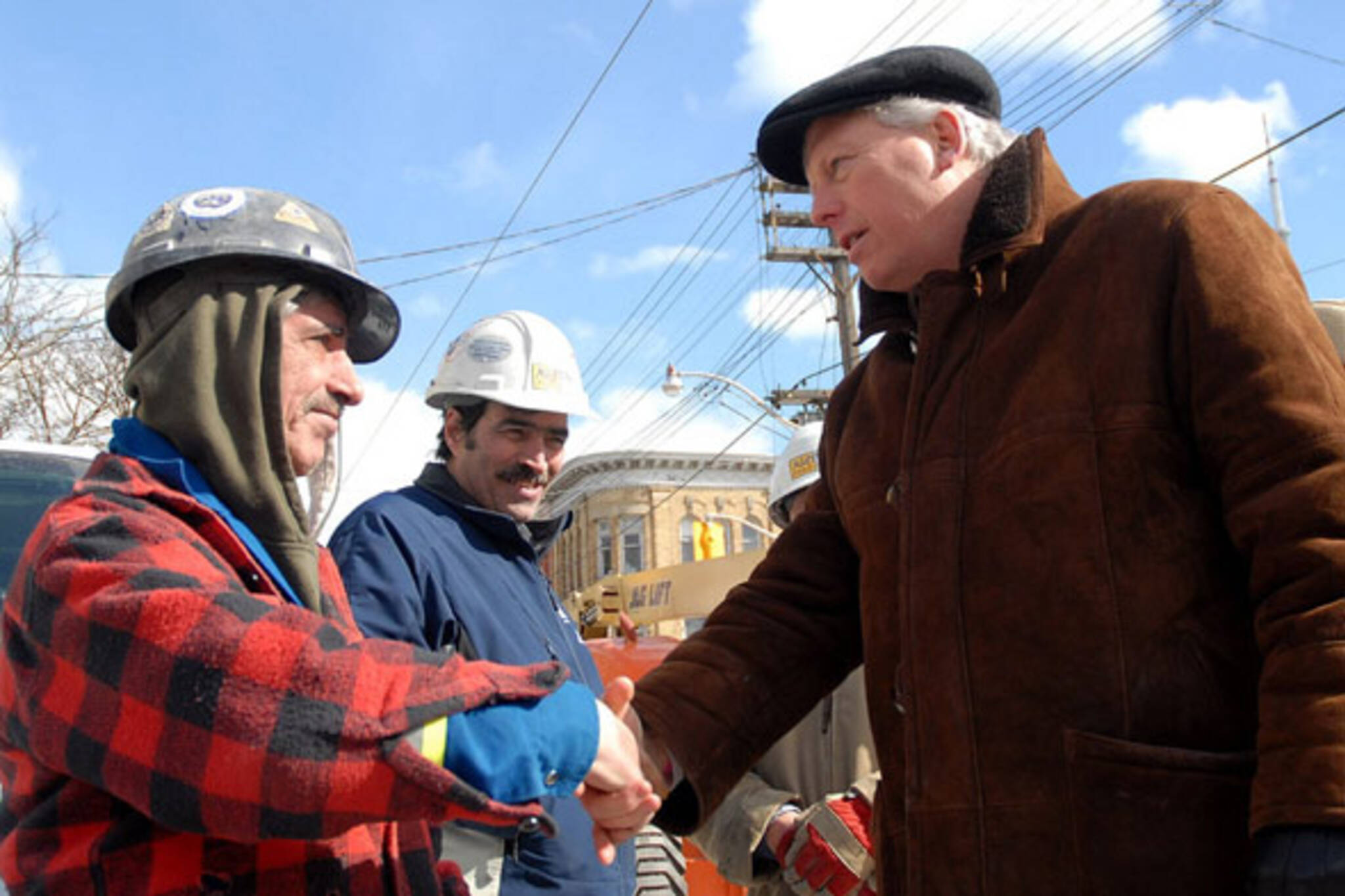 mayor miller and workers at fire