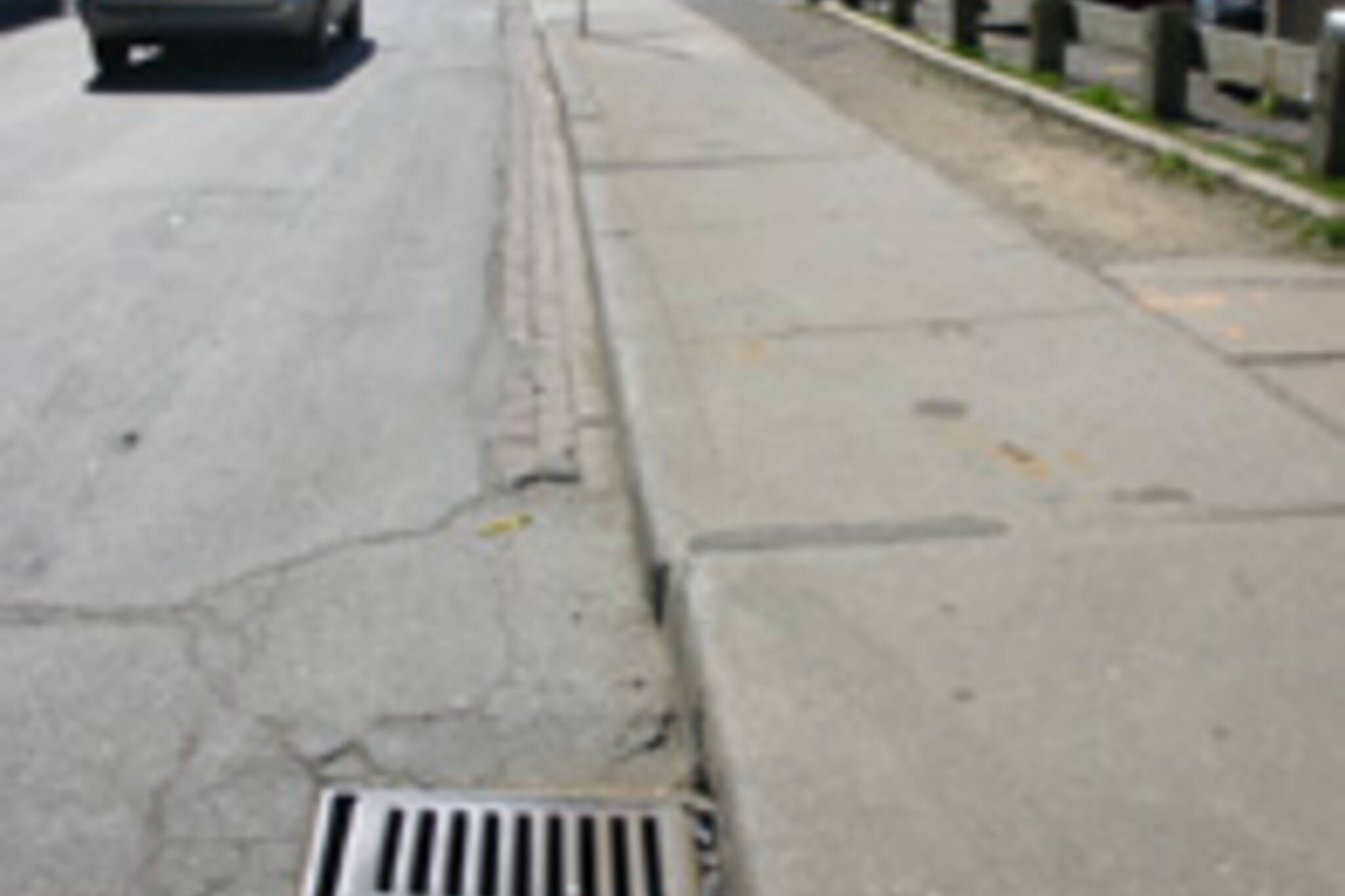 Tire catchers like this one on Yorkville can suddenly throw a cyclist to the curb