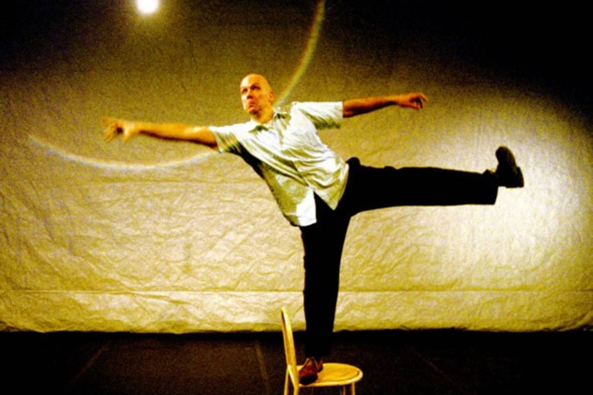 Rough House- Andy Massingham performs daring physical theatre with a chair and a lightbulb.  Photo: John Lauener