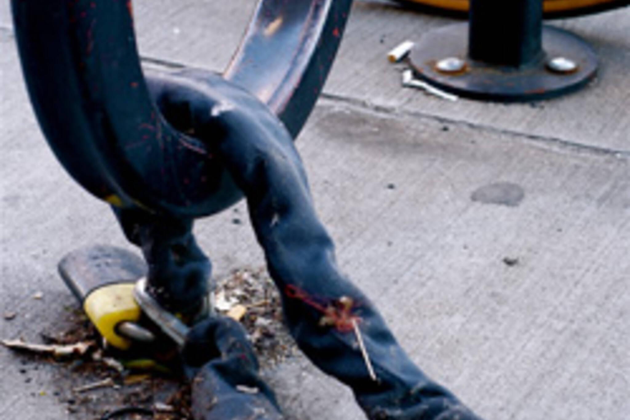 Bike lock on bike post after bike was stolen