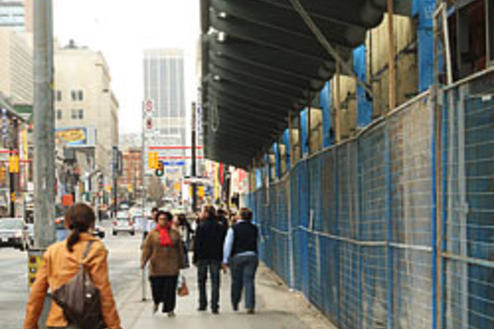 Sidewalk emerges at Yonge & Dundas