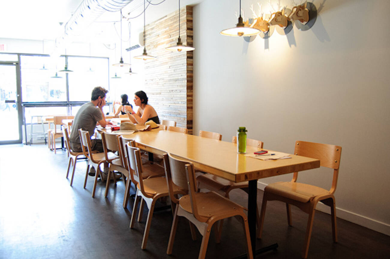 french cafe brings croissants and a communal table to. Black Bedroom Furniture Sets. Home Design Ideas