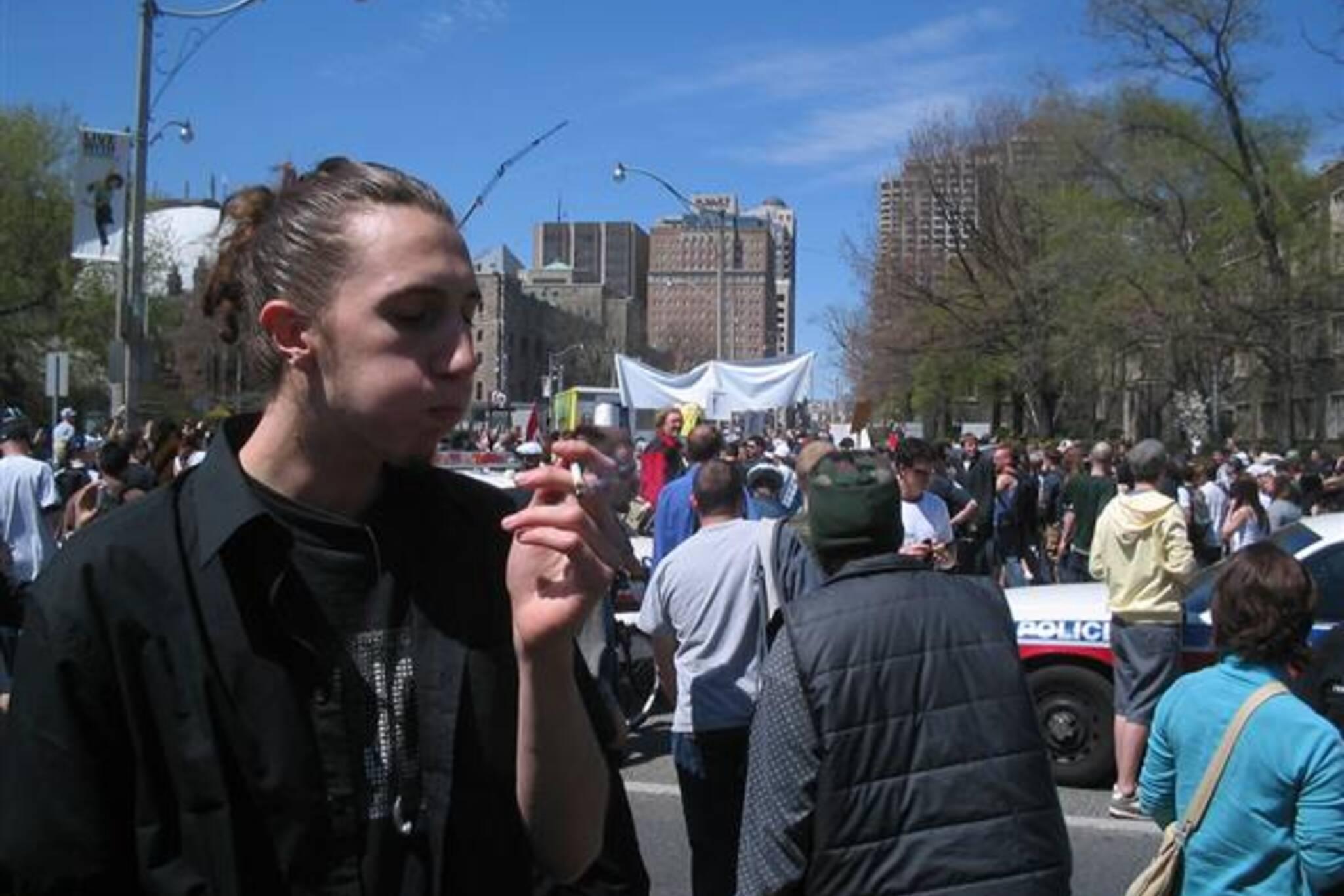 Anton holds his smoke