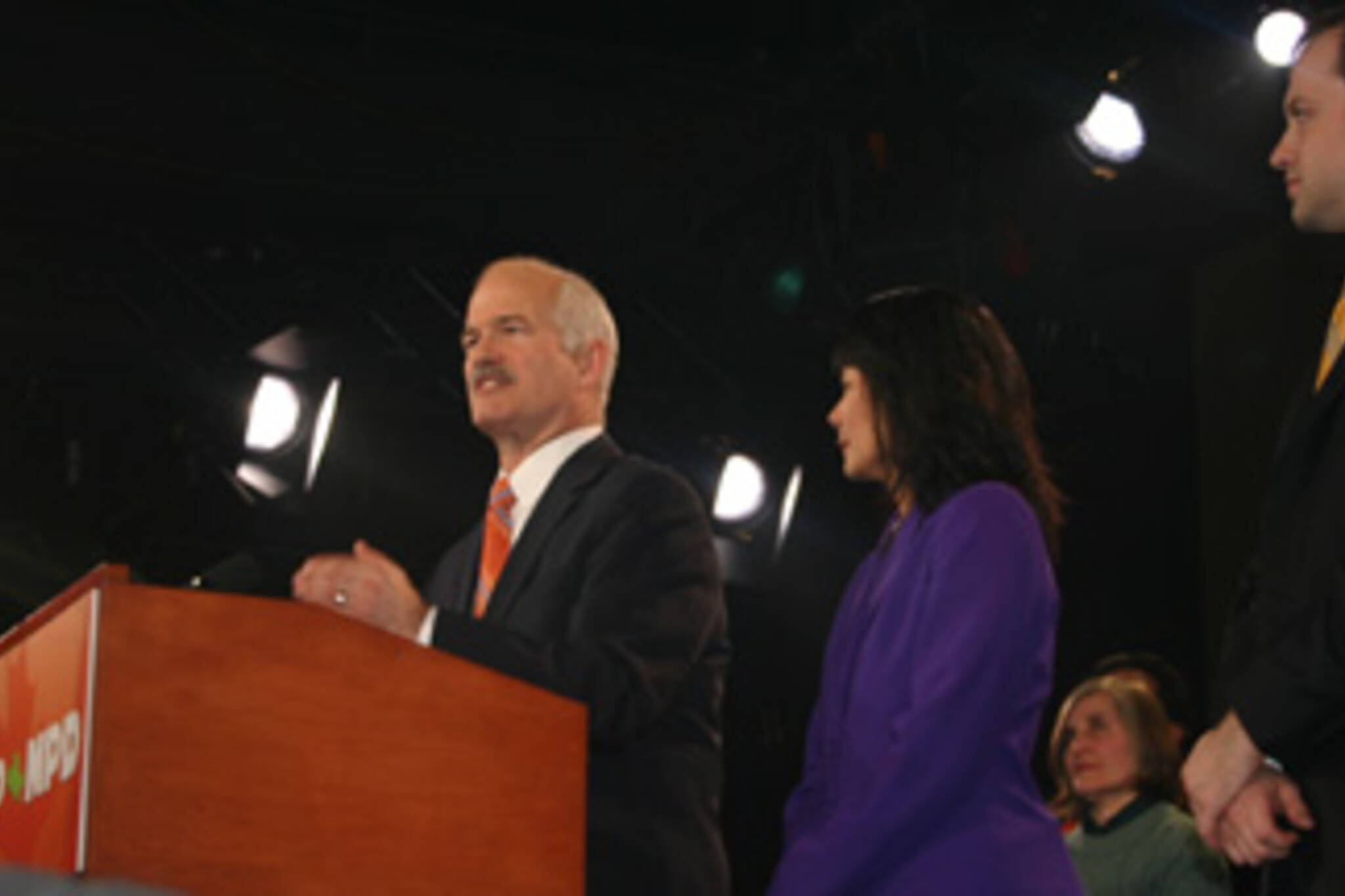 Jack Layton, with wife Olivia Chow and son, tell the crowd what they want to hear