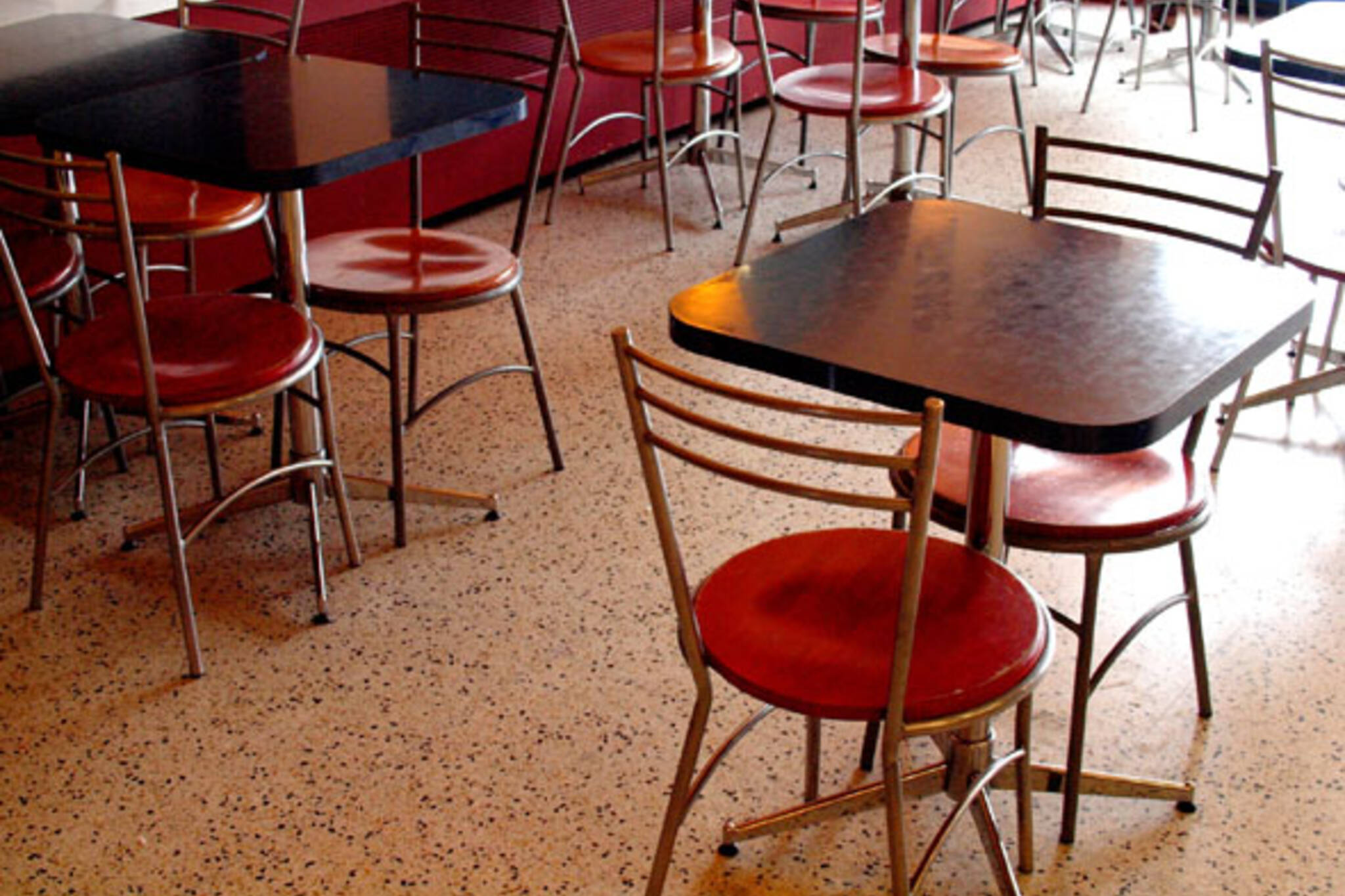 Empty chairs inside La Paloma