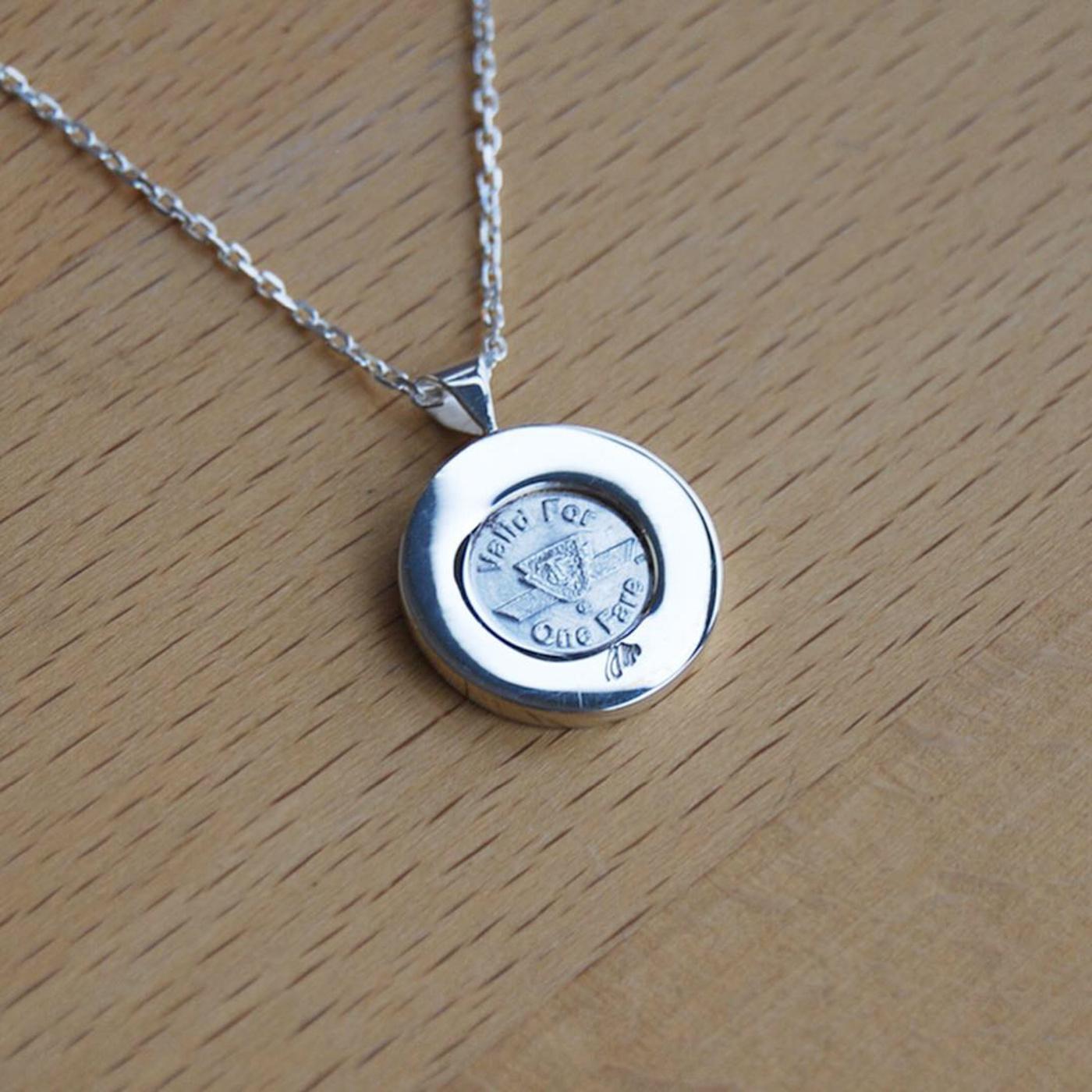 ttc token necklace
