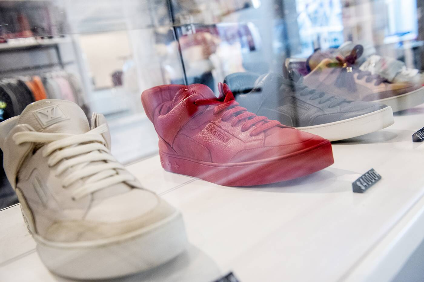 7860d4f220e Not so cheap: glass displays dedicated to Kanye West's shoe designs  including some from his original Louis Vuitton collaboration released in  2009.
