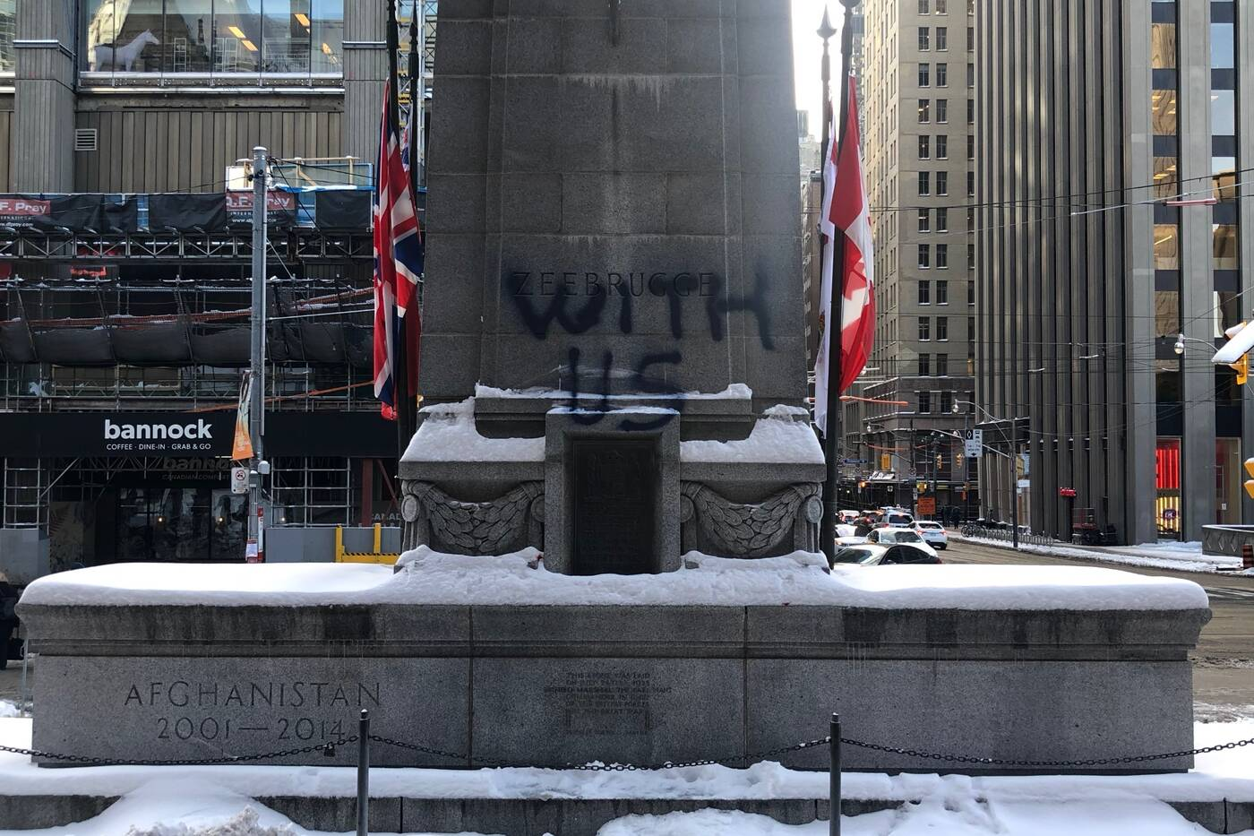 One of two phrases spray painted on the Old City Hall Cenotaph